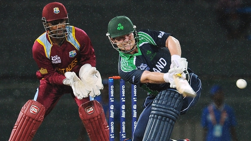 Paul Stirling plays a shot as West Indies wicketkeeper Denesh Ramdin looks on