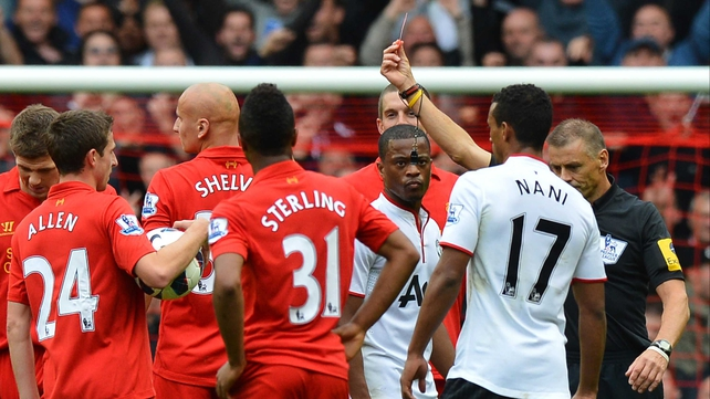 Referee Mark Halsey shows Jonjo Shelvey a red card in the Anfield clash against Manchester United