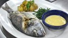 Stuffed whole sea bream - Served with roasted herbal potatoes and samphire grass served with beurre blanc sauce.