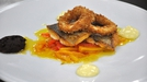 Pan-fried sea bream with deep fried calamari,  - Served with Red and Yellow Pepper Escabeche, Black Olive Tapenade and Aioli.