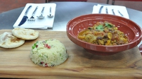 Spiced Fruit and Chicken Tagine - Served with Pomegranate, Coriander, Cous Cous and Flat Bread