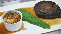 Fillet steak with pureed spinach - A delicious main of fillet steak with pureed spinach, pied bleu mushroom gratin and red wine jus from MasterChef Ireland