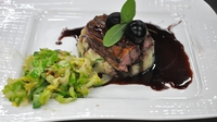 Seared Ballydehob Duck Breast  - Served with a Cherry & Port Reduction, on a bed of Celeriac & Chive Mashed Potato accompanied by York Cabbage with Smoked Bacon & Walnut.