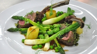 Herb crusted rack of lamb with seasonal vegetables - Served with fondant potatoes and a Madeira jus
