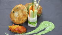 Cod and smoked coley fishcake  - Served with spicy tomato and onion chutney & bouquet salad with basil and anchovy dressing