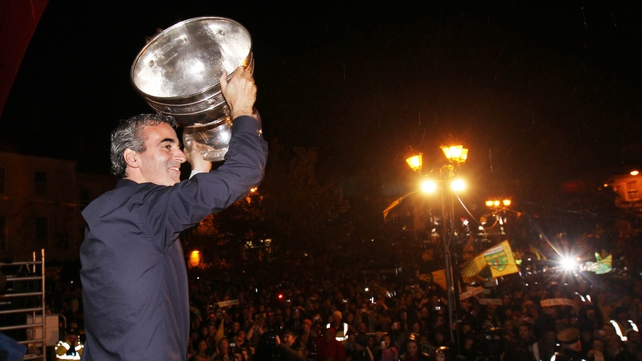 Jim McGuinness carries the Sam Maguire last night