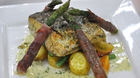 Pan-fried fillet of Carlingford Hake - Served with a warm summer potato salad, chargrilled parma-wrapped asparagus spheres with a dill beurre blanc