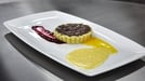 Orange and chocolate tart with white chocolate custard - Served with raspberry coulis and passion fruit coulis