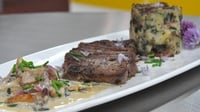 Pan seared rib-eye steak with bubble and squeak cake - Served with a mushroom crème fraiche sauce with chive