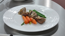 Pan fried quail with glazed vegetables and pan juices