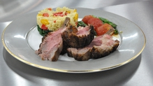 Rack of lamb with spiced cous cous and oven-roasted vegetables