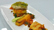 Hake with herb crumb, potato cake and polenta chips