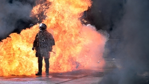 Petrol bombs were thrown at police in the capital