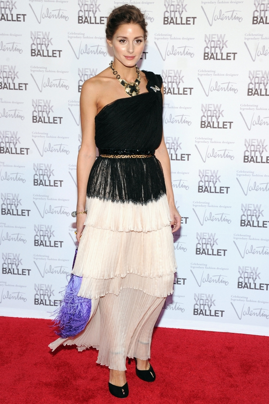 We're divided on this one, love the top half of the dress but the layered pleated skirt is a bit twee. Not a fan of that purple handbag either Olivia...