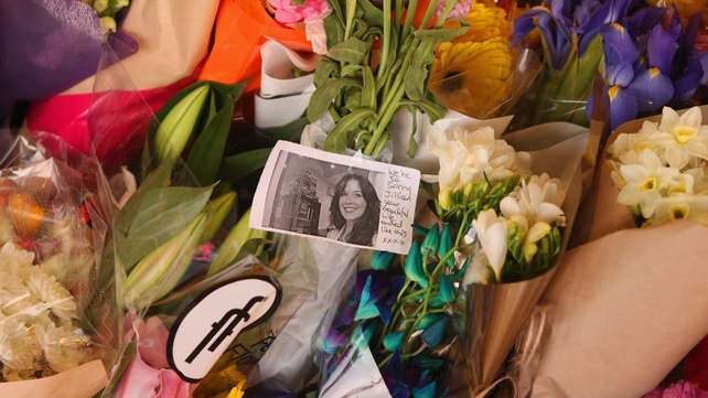Flowers have been left outside the shop that captured CCTV footage of Jill Meagher