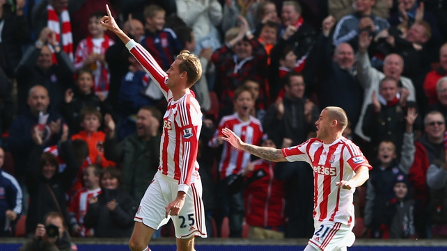 Peter Crouch and Michael Kightly celebrate