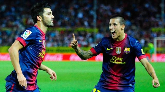 David Villa (L) and Cristian Tello celebrate