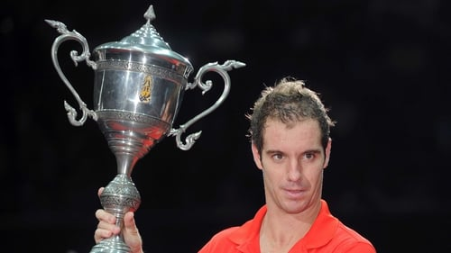 Richard Gasquet shows off the trophy