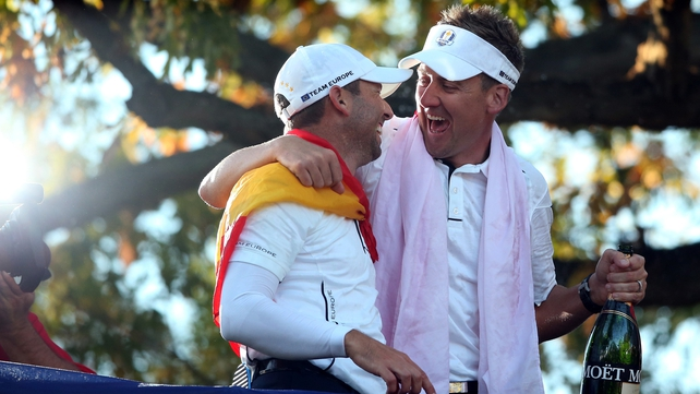 Golfer of the tournament Ian Poulter celebrates with Sergio Garcia who had a remarkable finish to beat Jim Furyk in his singles match