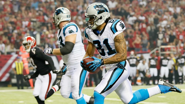 Kealoha Pilares of the Carolina Panthers pulls in this reception he rushed for a touchdown