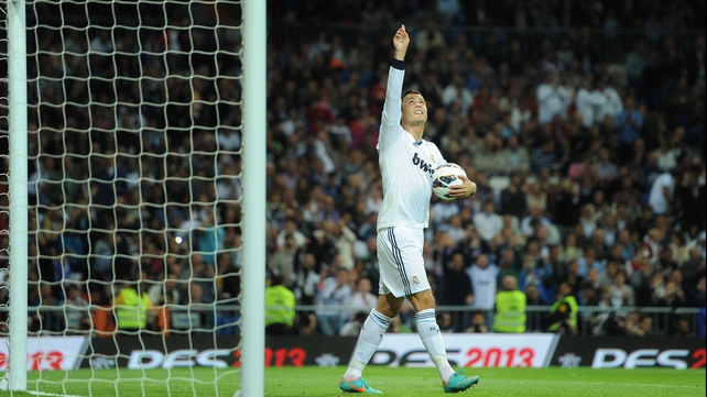 Ronaldo celebrates with the match ball