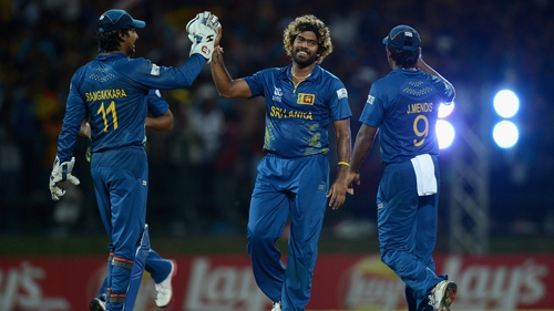 Lasith Malinga of Sri Lanka celebrates with Kumar Sangakkara and Jeevan Mendis after bowling out Samit Patel of England