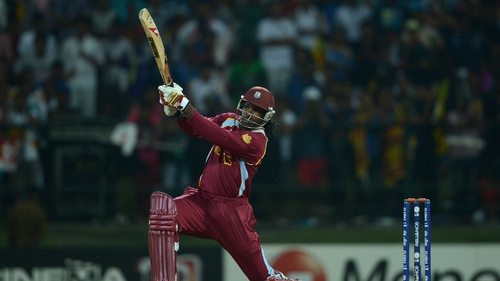 Chris Gayle of the West Indies hits out for six during the Super Over