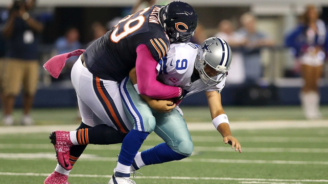 Henry Melton of the Bears sacks quarterback Tony Romo