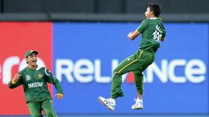 Raza Hasan of Pakistan celebrates the wicket of Shane Watson of Australia