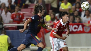 Carles Puyol suffered a dislocated left elbow against Benfica