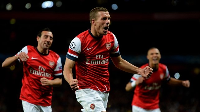 Lukas Podolski celebrates scoring Arsenal's second goal at Emirates Stadium
