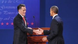 Mitt Romney and Barack Obama shake hands at the conclusion of the first presidential debate at the University of Denver