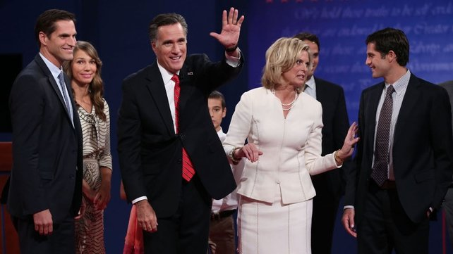 Mitt Romney and his wife Ann stand with their family after the debate in Denver