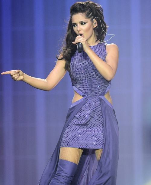 Cheryl Cole dons an array of costumes for stage show