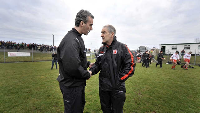 Donegal manager Jim McGuinness (l) and his Tyrone counterpart Mickey Harte will pit their wits against each other in Ulster