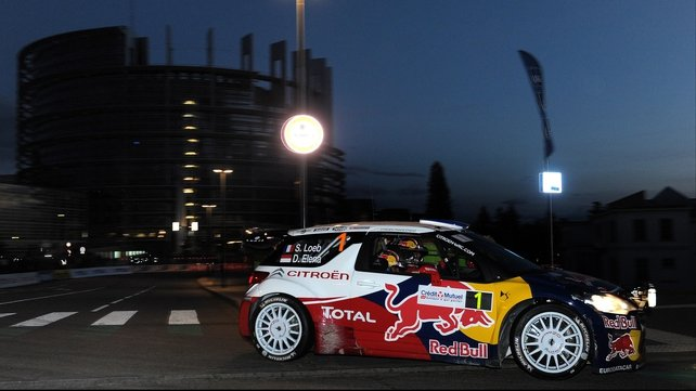 Sebastien Loeb and co-driver Daniel Elena steer their Citroen DS3 WRC in front of the European Parliament