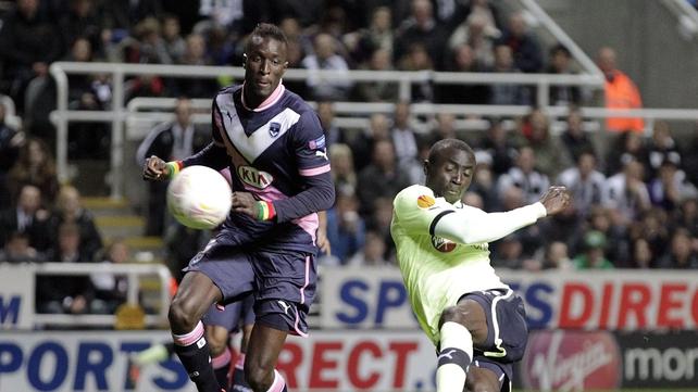 Newcastle United's striker Papiss Cisse (r) scores his goal against Bordeaux