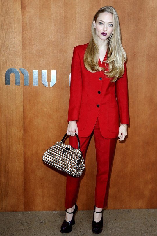 Wowee, Amanda Seyfried looks all grows up in a red pant suit. Just look at that hair too!