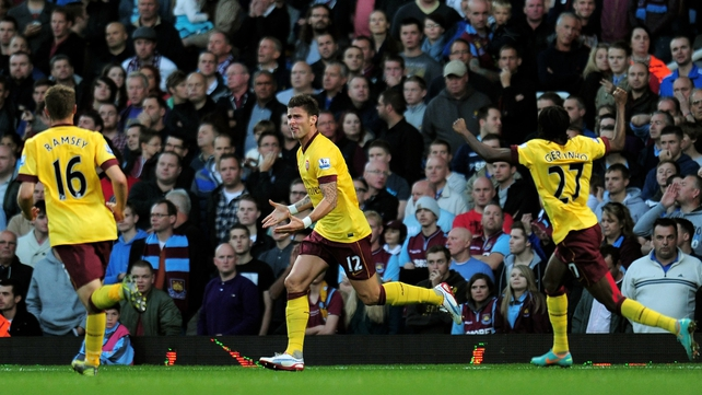 Oliver Giroud found the net for his new  employers in the Gunners' 3-1 win at Upton Park