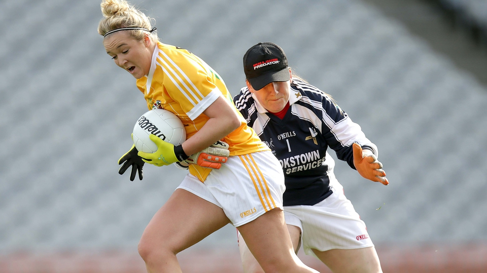 Anna Finnegan of Antrim rounds Louth goalkeeper Una Pearson in the Junior Ladies football final at Croke Park