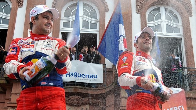 Sebastien Loeb (right) celebrates with co-driver Daniel Elena