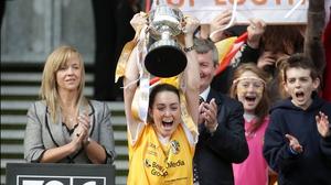 Antrim captain Clare Timoney raises the Junior trophy