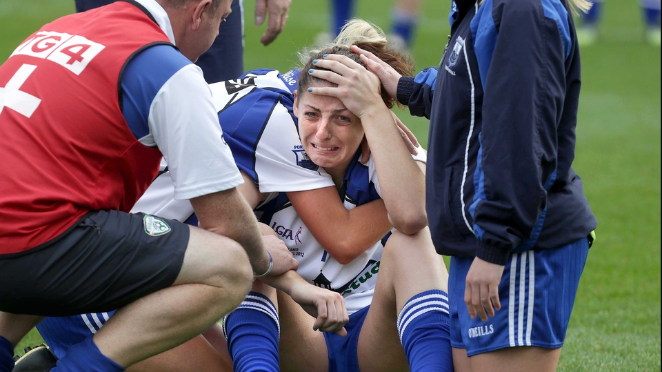 Waterford's Michelle Ryan is comforted by teammates after the Déise's 1-12 to 1-05 defeat