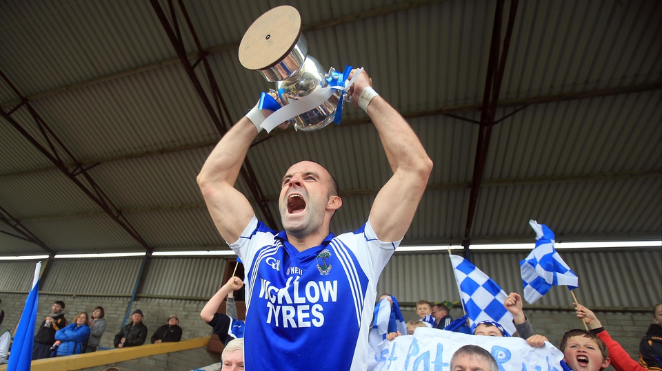 St Patrick's Darragh O'Sullivan lifts the trophy after their 1-12 to 0-14 win over Baltinglass in the Wicklow football final