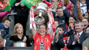 Cork captain Rena Buckley raises the All-Ireland Ladies Senior Football Championship trophy after the Rebelettes ran out 0-16 to 0-07 winners