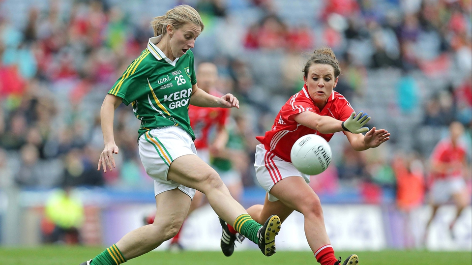 Cork's Orlagh Farmer attempts to block down Margaret Fitzgerald of Kerry