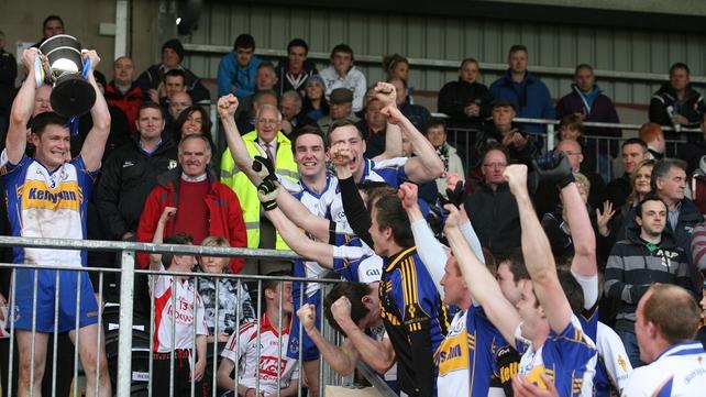 Enda McGinley holds the cup aloft as Errigal Ciarán celebrate