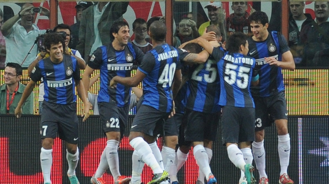 Inter players celebrate after Samuel found the net