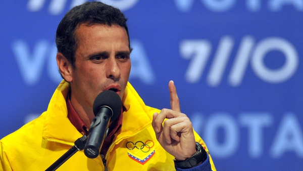 Henrique Capriles speaks to supporters after receiving news of his defeat in Caracas