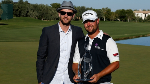 Tournament host Justin Timberlake with champion Ryan Moore